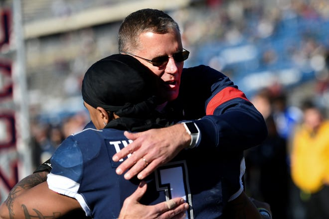 """UConn head coach Randy Edsall hugs one of his players during senior day in 2019. The Susquehannock High School graduate got emotional on Wednesday in explaining the Huskies' decision to cancel the 2020 football season, saying the lives of his players were """"more important than money."""""""