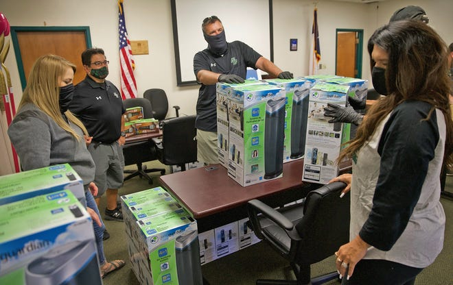 Staff at Grape Creek ISD prepare supplies to keep students returning to school safe from COVID-19 for delivery to schools Thursday, Aug. 6, 2020.