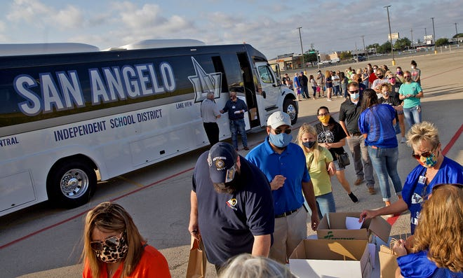 Educators joining the San Angelo ISD for the upcoming school year line up for a welcoming event Thursday, Aug. 6, 2020.