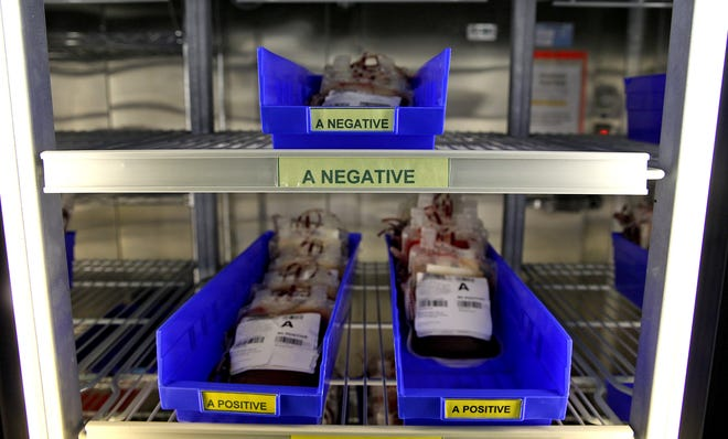 Blood samples sit in a refrigerated storage unit at the Vitalant blood donation center in San Angelo on Thursday, Aug. 6, 2020.