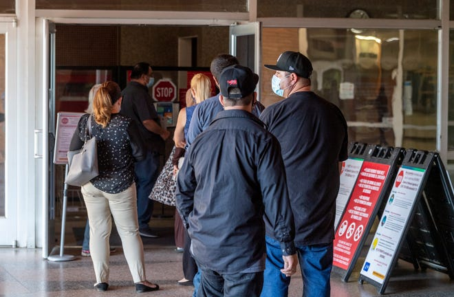 People wait their turn Thursday, August 6, 2020 to enter Tulare County Superior Court.