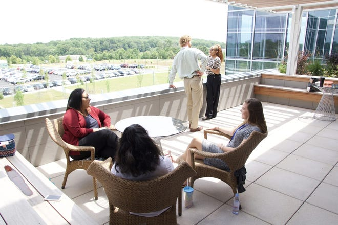 CSC employees enjoying each other's company on the patio at the company's headquarters in Wilmington, DE.