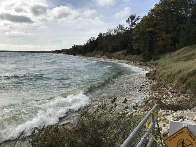 High water levels in Lake Michigan have eroded the shoreline and closed one of the beaches at Whitefish Dunes State Park in Door County, Wis.