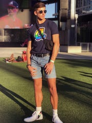 Garrett Weed, a senior at Georgia State University, attends an Atlanta Braves game in the summer of 2019 celebrating LGBT pride.