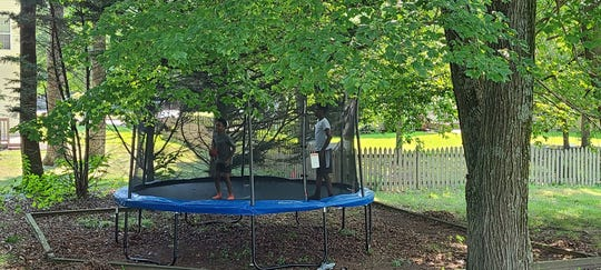 Tracey Marshall-Underwood bought a trampoline for her children instead of going on summer vacation.