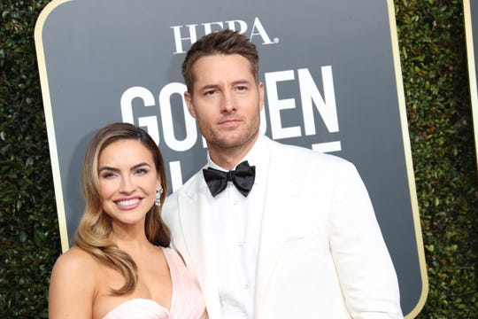 Chrishell Stause, and then-husband, actor Justin Hartley, arrive at the Golden Globes in Beverly Hills, Calif. on Jan. 6, 2019.