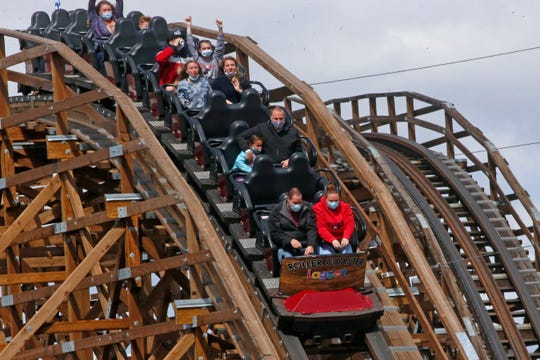 Riding a roller coaster with face masks and social distancing in Farmington, Utah, in 2020.
