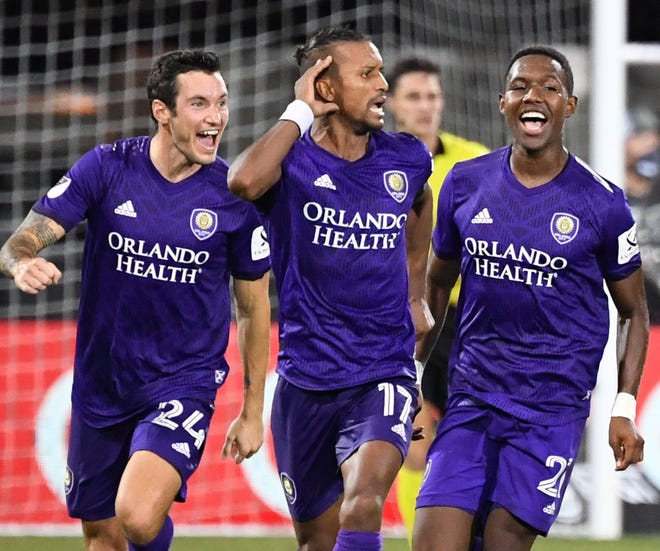 Orlando City SC's Nani (17) celebrates with teammates after scoring the game-winning penalty kick to defeat the Los Angeles FC in the MLS is Back Tournament quarterfinals at ESPN Wide World of Sports Complex.