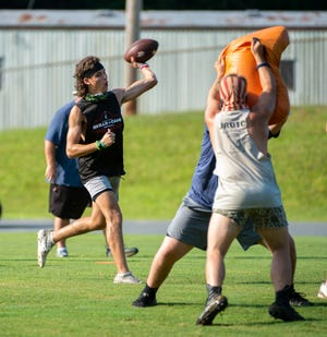 Randleman quarterback Christian Long makes a throw on Wednesday during summer workouts at the school. The NCHSAA allowed the use of footballs beginning on Monday. [PJ Ward-Brown for The Courier-Tribune]