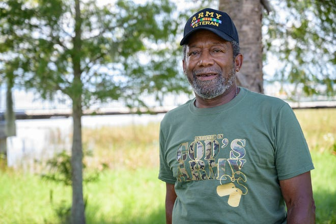 Veteran Mel Benn at Ferran Park in Eustis, where he used to walk around as a boy and still frequently takes walks there. [Cindy Peterson/Correspondent]
