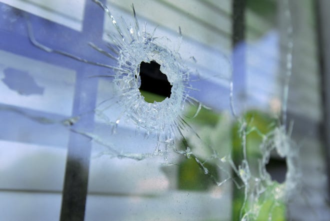 At least 10 bullet holes still remain evident in the windows and siding of a home on South College Circle from a shooting Saturday night that left a 12-year old Jacksonville boy, who was in his bed at the time, paralyzed and another person injured. [Bob Self/Florida Times-Union]