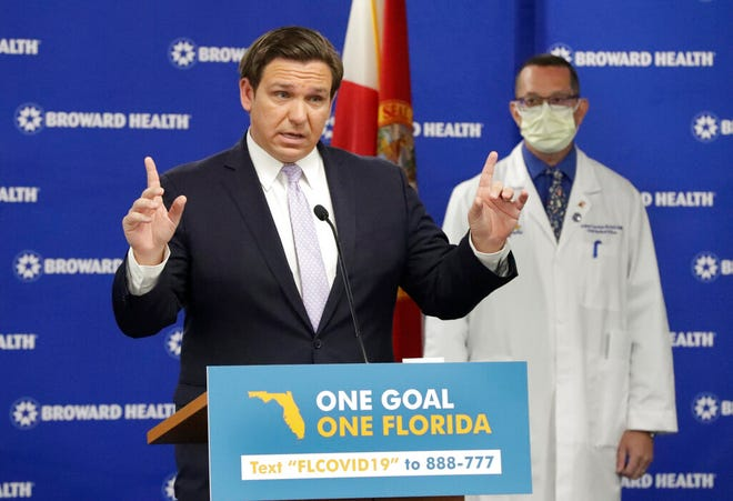 Florida Gov. Ron DeSantis speaks about COVID-19 during an Aug. 3 news conference in Fort Lauderdale. DeSantis has called all summer for schools to return to in-person classes in the fall. [AP Photo/Wilfredo Lee]