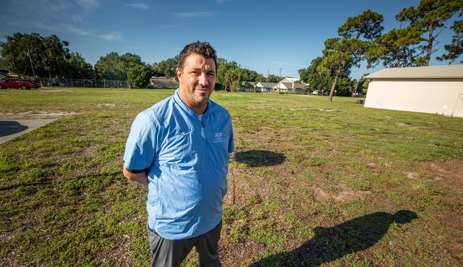 Jordan Christian Prep headmaster Mike Guastella shows where the field house, gym and locker rooms are going to be built at Jordan Christian's new location at Starting Point Church in Auburndale. [ERNST PETERS/THE LEDGER]