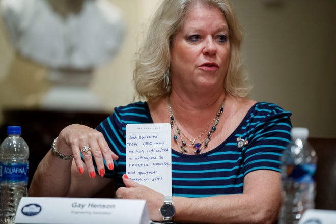 Gay Henson, president of the Engineering Association, holds a message from the CEO of the Tennessee Valley Authority that was given to President Donald Trump during a meeting with U.S. tech workers before Trump signed an Executive Order on hiring American workers at the White House on Monday. [ALEX BRANDON/THE ASSOCIATED PRESS]