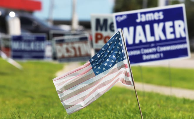 File photo: Election signs line a sidewalk outside the Okaloosa County Administration Building in Florida. [MICHAEL SNYDER/DAILY NEWS]