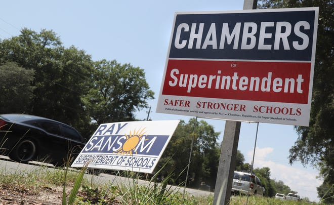 Election signs for Ray Sansom and Marcus Chambers are placed side-by-side o Beal Parkway in Cinco Bayou. The two are running for Okaloosa Country Superintendent of Schools.