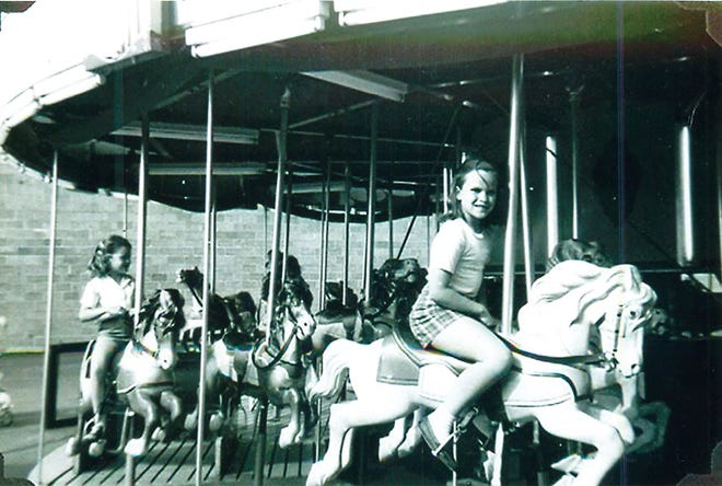 Girls have fun riding the Funland merry-go-round in Downtown Oak Ridge around 1960.