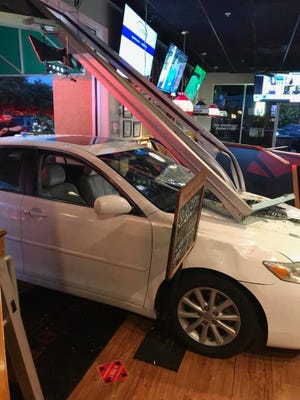 A white sedan crashed through a wall at Beef O'Brady's burger and wings restaurant in North Port.