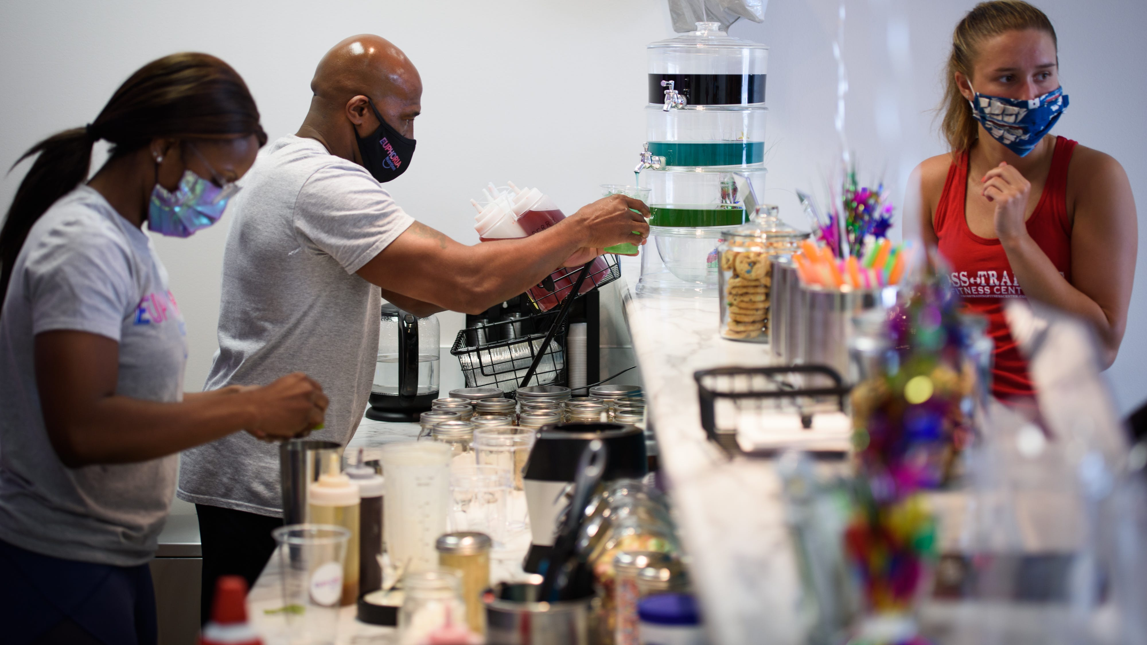 Kwamdre, left, and Everitt Willamson work on making drinks for customers at Euphoria Nutrition on Friday, Aug. 7, 2020.