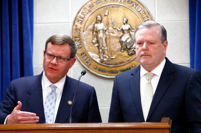 FILE - In this March 28, 2017, file photo, Republican leaders Rep. Tim Moore, left, and Sen. Phil Berger hold a news conference in Raleigh, N.C. (Chris Seward/The News & Observer via AP, File)