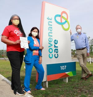 From left, RN Case Manager Kendle Jones, CNA Hospice Aide Bako Trull, and Spiritual Care Coordinator Michael Bryan stand for a photo on April 22, 2020 at Covenant Care in Panama City. [PATTI BLAKE/THE NEWS HERALD]