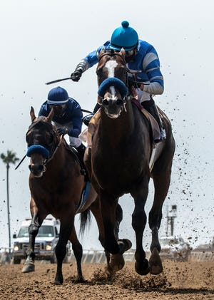 Thousand Words, right, with Abel Cedillo aboard, outlegs Cezanne, left, with Flavien Prat aboard, to win the $100,000 Shared Belief Stakes horse race Saturday, Aug. 1, 2020, at Del Mar Thoroughbred Club in Del Mar, Calif.