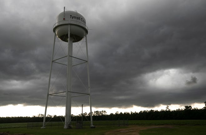 A thunderstorm moves over the Tyrrell County water tower at the water treatment plant on Thursday, July 23, 2020. Photo by Robert Willett / The News & Observer / North Carolina News Collaborative