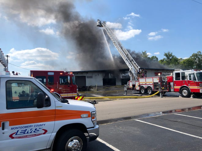The Action Gymnastics building off Industrial Drive near West Dunbar Cave caught fire. Aug. 7, 2020