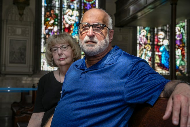 Vice President of Dignity Detroit Carolyn Shalhoub, 73, left, of Royal Oak poses with President Frank D'Amore, 67, of Dearborn at the Sacred Heart Chapel at Marygrove College  as they speak out about the Catholic Archdiocese of Detroit kicking out groups that are open to the LGBTQ community.