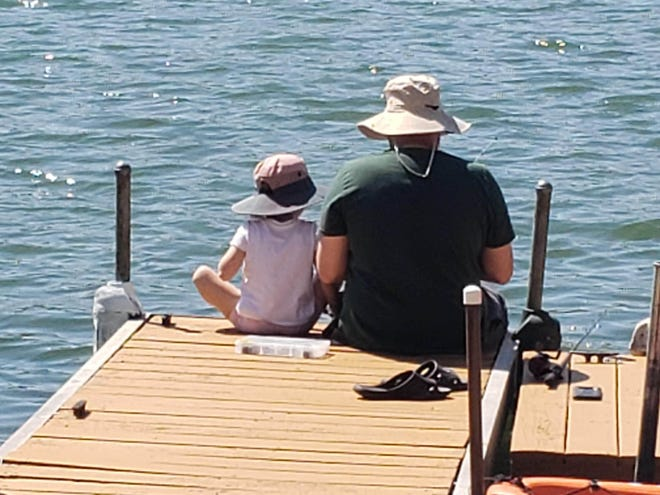 John and Rey Ciambelli bond over fishing while the family isolates to avoid the risk of COVID-19. They are among the increased number of Michiganders who have turned to fishing as a way to safely enjoy the outdoors during the pandemic.