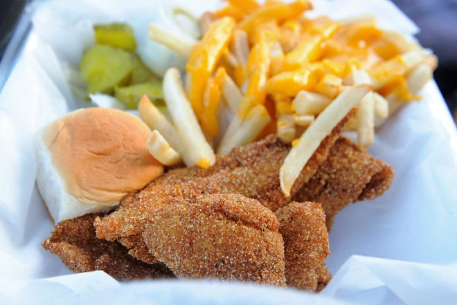 Fried flounder and whiting in a light and crunchy, lightly-sweet cornmeal breading with cheese fries from the Tri-State Snack Shop.