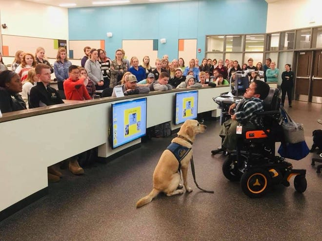 Dustin Gilmer and service dog, Carver