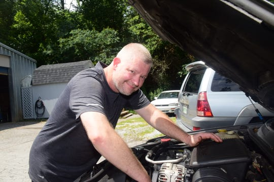 Owner Kenny Allison checks out an engine at Asian Auto Specialists at 7130 Oak Ridge Highway. Monday, Aug. 3, 2020.