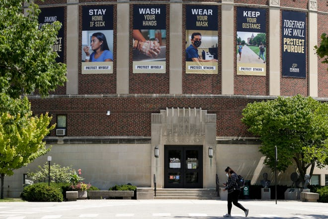 """""""Protect Purdue"""" banners hang from Purdue University's Elliott Hall of Music, Friday, Aug. 7, 2020 in West Lafayette."""