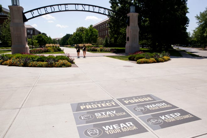 """Protect Purdue"" stickers are placed near the Gateway to the Future Arch, Friday, Aug. 7, 2020 in West Lafayette."