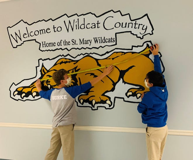 The mascot on the wall at St. Mary Catholic School in Pinckney helps students visualize six feet of physical distancing.
