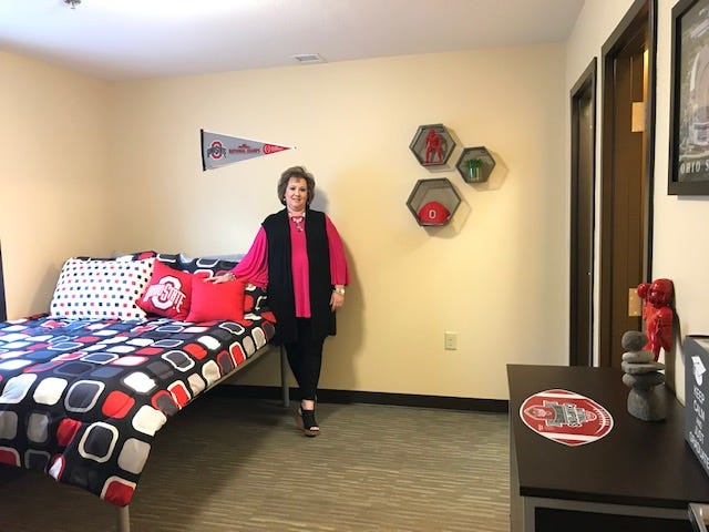 Melissa Miller, general manager for the Buckeye Village Apartments on Lexington-Springmill Road, shows a visitor a typical student apartment bedroom which comes furnished. Every student gets their own bedroom and bathroom but students share the common space of living area and kitchen. With COVID-19 restrictions, the facility is only housing one student per bedroom with no double occupancy rooms like they have offered in the past. Lou Whitmire/News Journal