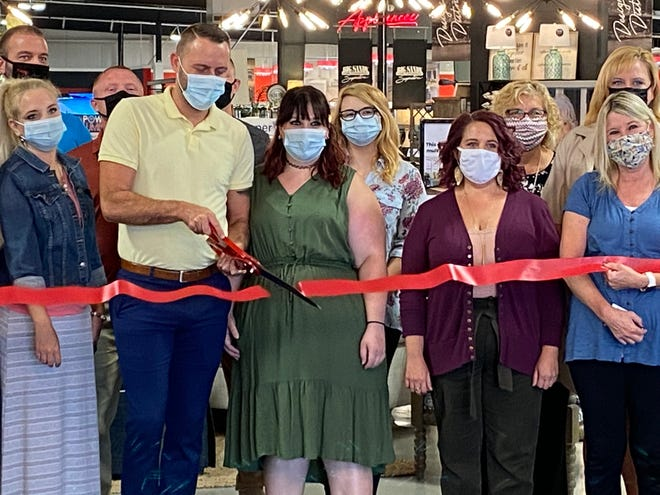 Big Sandy Store Manager Zachary Lucas cuts the ribbon with staff and Marion Chamber of Commerce members at a VIP event Thursday, August 6, 2020 to celebrate the new Marion location. The store is located at 2048 Marion-Mount Gilead Road.