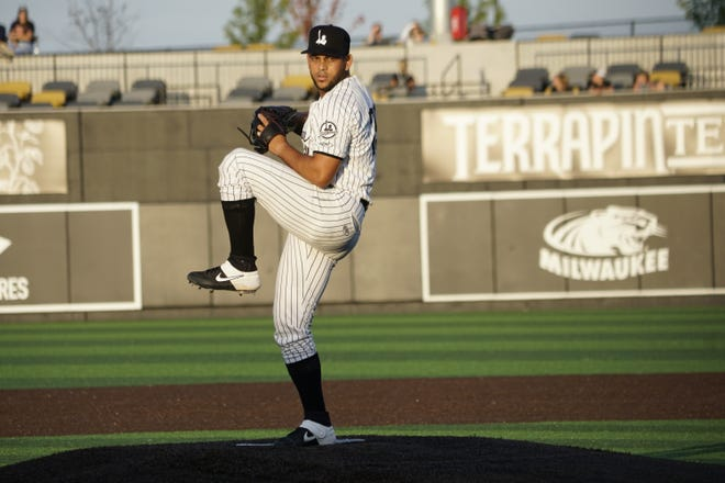 Milwaukee Milkmen pitcher Henderson Alvarez throws a pitch against the Sioux Fall Canaries. Alvarez made his debut with the Milkmen on Wednesday in hopes to get back to the majors.