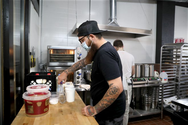 Adam Pawlak, the chef-owner of Egg & Flour Pasta Bar, works in the kitchen to reopen his Bay View location on Aug. 10. The counter-service restaurant, at 2273 S. Howell Ave., has been closed for five months because of the coronavirus pandemic.