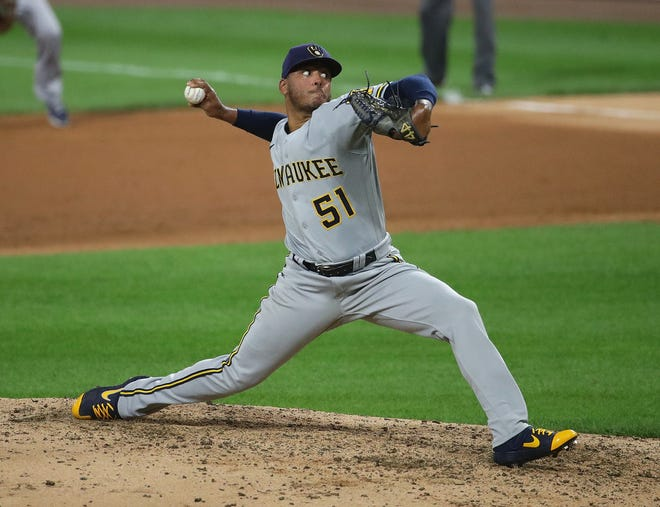 Freddy Peralta pitches in relief for the Brewers.