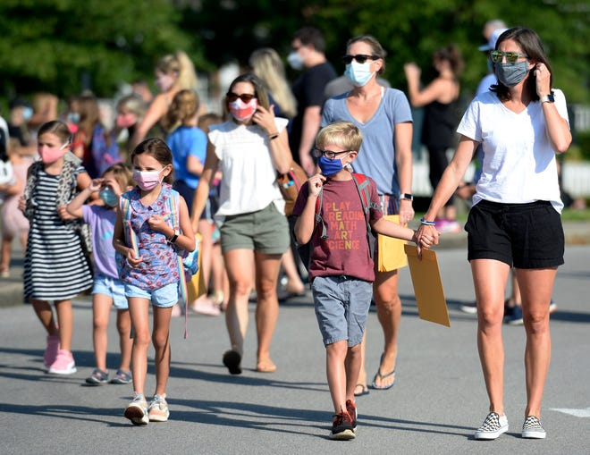 Pearre Creek Elementary School students and parents arrive for the first day of school on August 7, 2020, in Franklin, Tenn.