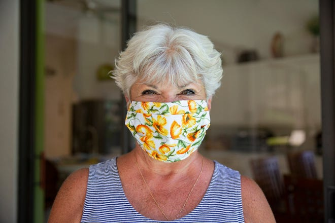 Shari Mink models a mask she made, Thursday, Aug. 7, 2020, at her home in Bonita Springs.