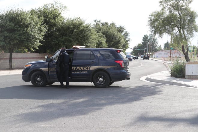Las Cruces police respond to a crash near Frenger Park on Thursday, Aug. 6, 2020. Police later said they were investigating a death at the crime scene.
