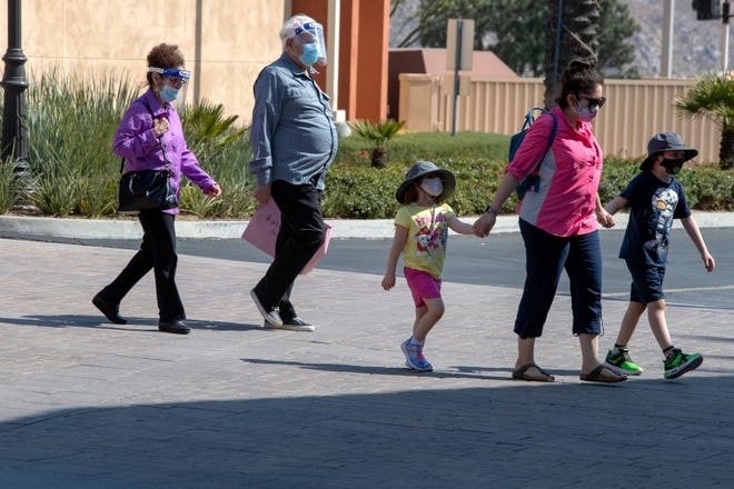 Shoppers wear masks to protect themselves and others from the spread of the coronavirus while walking around at the Cabazon Outlets in Cabazon, Calif., on Tuesday, August 4, 2020.
