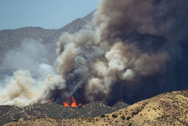 The Apple Fire continues to burn in the foothills north of Cabazon sending large plumes of smoke toward the Coachella Valley, August 7, 2020.