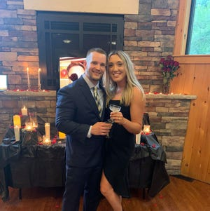 "Cody Garrod proposed marriage to Megan Santy with a little help from Chris Harrison, host of ABC's ""The Bachelor."""