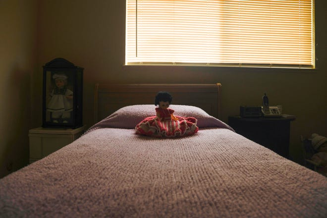 A doll rests on a bed in the only bedroom of Mary Martinez's Salinas apartment. Aug. 7, 2020.
