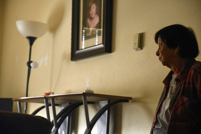 A framed portrait of Martinez's sister hangs in the living room. Aug. 7, 2020.