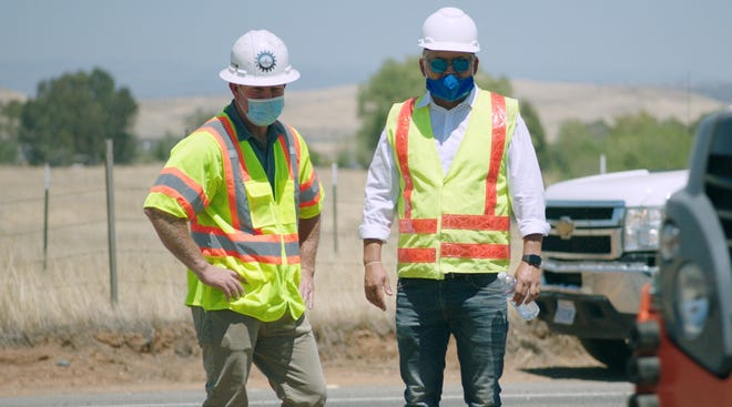TechniSoil president Sean Weaver, right, looks over the work with contractor Darren Coughlin.